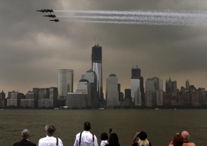 Members of the U.S. Navy Blue Angels fly over the World Trade Center in lower Manhattan as part of the 25th annual Fleet Week celebration in New York, May 23, 2012.  REUTERS/Eduardo Munoz
