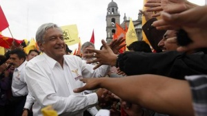 Andres Manuel Lopez Obrador, presidential candidate for the Party of the Democratic Revolution (PRD), greets his supporters after a rally in Toluca June 26, 2012. REUTERS/Edgard Garrido