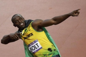 Jamaica's Usain Bolt celebrates victory in the men's 100m final. REUTERS/Max Rossi
