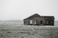 An abandoned home inundated with water at Shinnecock Bay in Southampton, New York, October 29, 2012.  REUTERS/Lucas Jackson