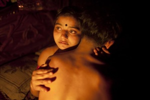 "Seventeen-year-old prostitute Hashi, embraces a Babu, her ""husband"", inside her small room at Kandapara brothel in Tangail, a northeastern city of Bangladesh, March 4, 2012.   REUTERS/Andrew Biraj"