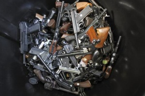 Handguns that were turned in by their owners are seen in a trash bin at a gun buyback held by the Los Angeles Police Department following the mass shooting at Sandy Hook Elementary School in Connecticut, in Los Angeles, California, December 26, 2012. REUTERS/David McNew