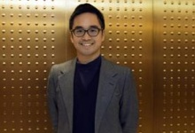 Hong Kong billionaire Adrian Cheng, the 33-year-old grandson of Hong Kong tycoon Cheng Yu-teng, poses for a photograph before an interview with Reuters at his office in Hong Kong, April 11, 2013. REUTERS/Tyrone Siu