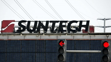 The Suntech Power Holdings logo is seen on the roof of a building at the company's headquarters in Wuxi, Jiangsu province March 21, 2013. REUTERS/Stringer 