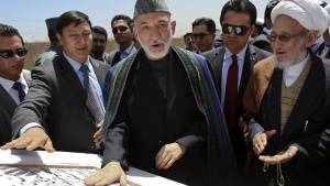 Afghan President Hamid Karzai (C) attends an inauguration ceremony of a residential area in Kabul, May 16, 2013. REUTERS/Omar Sobhani