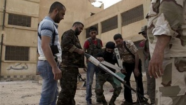 Free Syrian Army fighters prepare to launch a rocket in Deir al-Zor, May 18, 2013. The text on the wall reads &quot;Yes&quot;. Picture taken May 18, 2013.  REUTERS/Khalil Ashawi