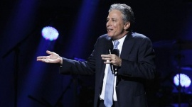 "Comedian Jon Stewart speaks during the ""12-12-12"" benefit concert for victims of Superstorm Sandy at Madison Square Garden in New York December 12, 2012.  REUTERS/Lucas Jackson"