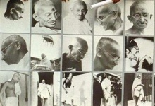Followers of Mahatma Gandhi stand behind his pictures during a rally to mark the 50th anniversary of his death in New Delhi January 30. REUTERS/Sunil Malhotra/Files