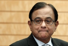 Finance Minister Palaniappan Chidambaram waits for the arrival of Japan's Prime Minister Shinzo Abe before their meeting at Abe's official residence in Tokyo April 1, 2013. REUTERS/Issei Kato/Files