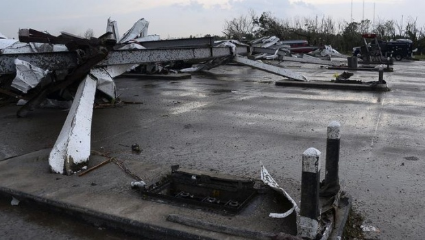 Gas pumps islands are seen without pumps after a tornado struck Moore, Oklahoma, May 20, 2013. REUTERS/Gene Blevins