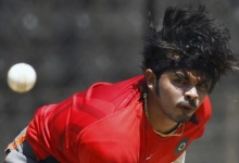 Shanthakumaran Sreesanth bowls a ball during a practice session before their ICC Cricket World Cup Group B match against Ireland in Bangalore March 5, 2011. REUTERS/Vivek Prakash/Files