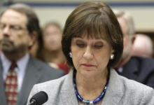 U.S. Director of Exempt Organizations for the Internal Revenue Service, Lois Lerner, takes her seat before a House Oversight and Government Reform Committee hearing on alleged targeting of political groups seeking tax-exempt status by the IRS, on Capitol Hill in Washington, May 22, 2013. REUTERS/Jonathan Ernst