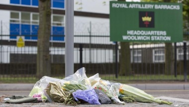 Floral tributes are seen outside the Royal Military Barracks, near the scene where a man was killed in Woolwich, southeast London May 23, 2013. REUTERS/Neil Hall