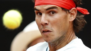 Rafael Nadal of Spain hits a return to Ernests Gulbis of Latvia during their men's singles match at the Rome Masters tennis tournament May 16, 2013. REUTERS/Tony Gentile