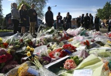 People view flowers left outside an army barracks near the scene of a killing in Woolwich, southeast London May 23, 2013. REUTERS/Luke MacGregor
