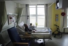 An unidentified man suffering from Alzheimer's disease and who refused to eat sleeps peacefully the day before passing away in a nursing home in the Netherlands. REUTERS/Michael Kooren