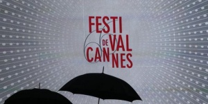 Umbrellas are pictured in front of a giant screen which displays the 66th Cannes Film Festival official logo in front of the Festival Palace during the Festival in Cannes May 18, 2013. REUTERS/Jean-Paul Pelissier