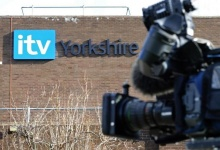 A TV camera stands outside the ITV television company's offices in Leeds, northern England March 4, 2009. REUTERS/Nigel Roddis/Files
