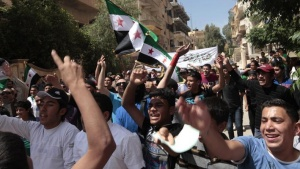 Demonstrators chant slogans and wave Syrian opposition flags during a protest against President Bashar al-Assad after Friday prayers in Raqqa province, east Syria, May 17, 2013. REUTERS/Hamid Khatib