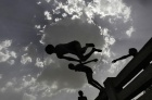 Boys jump into a canal during a hot day in New Delhi May 27, 2013. REUTERS/Anindito Mukherjee