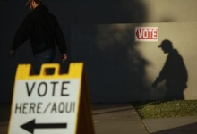 A voter casts his shadow on the wall as he arrives at the polling station outside Kenilworth School during the U.S. presidential election in Phoenix, Arizona November 6, 2012. REUTERS/Joshua Lott