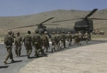 NATO soldiers board a Chinook helicopter after a security handover ceremony at a military academy outside Kabul June 18, 2013. REUTERS/Omar Sobhani