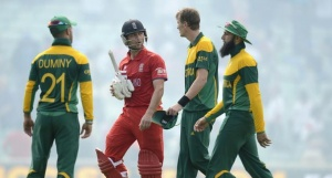 England's Jonathan Trott leaves the field with South Africa's JP Duminy (L), Chris Morris (2nd R) and Hashim Amla (R) after England won the ICC Champions Trophy semi final match at The Oval cricket ground, London June 19, 2013. REUTERS/Philip Brown