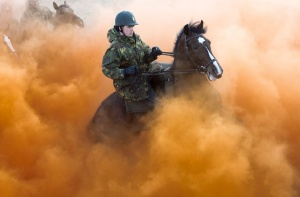 Members of the Dutch Royal Guard of Honour guide their horses through smoke during a rehearsal ahead of the Dutch 2014 budget presentation, at the beach of Scheveningen September 16, 2013.   REUTERS/United Photos/Toussaint Kluiters