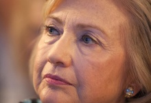 Former Secretary of State and former first lady Hillary Clinton sits and watches during the Clinton Global Initiative 2013 (CGI) in New York September 24, 2013. REUTERS/Carlo Allegri