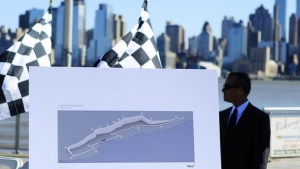 A public relation staff stands behind a race course map before an announcement that New Jersey will host a round of the Formula One world championship auto racing series starting in 2013 in Weehawken October 25, 2011. REUTERS/Lucas Jackson/Files