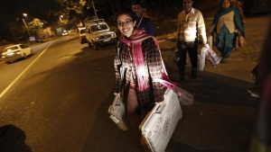 Polling officers carry electronic voting machines (EVM) as they leave a polling station at the end of polls, during the state assembly election in New Delhi December 4, 2013. REUTERS/Adnan Abidi (INDIA - Tags: POLITICS ELECTIONS) - RTX163HB
