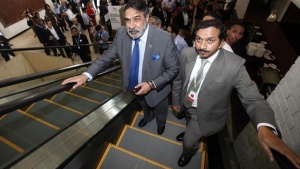 Commerce Minister Anand Sharma (front, 2nd R) arrives at the ninth World Trade Organization (WTO) Ministerial Conference in Nusa Dua, on the Indonesian resort island of Bali December 6, 2013. REUTERS/Edgar Su