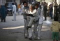 Family members of an elderly voter carry him after he cast his vote outside a polling station during the state assembly election in New Delhi December 4, 2013. REUTERS/Adnan Abidi
