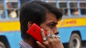 A man uses a Nokia mobile phone to make a call on a street in Kolkata December 12, 2013. REUTERS/Rupak De Chowdhuri/Files