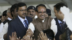 Shivraj Singh Chouhan (2nd R), chief minister of Madhya Pradesh, greets his Bharatiya Janata Party (BJP) supporters during Chouhan's swearing-in ceremony in Bhopal December14, 2013. REUTERS/Raj Patidar