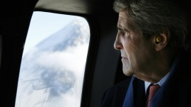 U.S. Secretary of State John Kerry looks out at the Swiss Alps during a helicopter ride from Davos to Zurich January 25, 2014. REUTERS/Gary Cameron