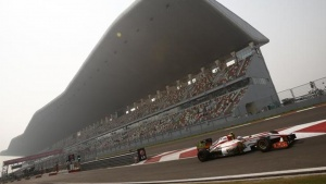 HRT Formula One driver Narain Karthikeyan of India drives out of the pit lane during the first practice session of the Indian F1 Grand Prix at the Buddh International Circuit in Greater Noida, on the outskirts of New Delhi, October 26, 2012. REUTERS/Vivek Prakash/Files