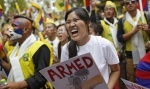 Tibetan exiles shout slogans during a protest in New Delhi March 10, 2014. REUTERS/Anindito Mukherje