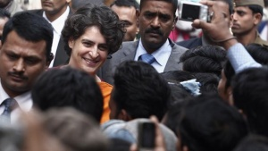 Priyanka Gandhi, daughter of the chief of ruling Congress party Sonia Gandhi, meets Congress party supporters during a stopover in Gauriganj town as part of her pre-election campaign in Uttar Pradesh January 17, 2012. REUTERS/Adnan Abidi/Files