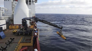 Operators aboard the Australian Defense Vessel Ocean Shield move the U.S. Navy's Bluefin 21 autonomous underwater vehicle into position for deployment in the Southern Indian Ocean, as the search continues for the missing Malaysia Airlines Flight 370, in this handout picture taken April 14, 2014. REUTERS/U.S. Navy/Mass Communication Specialist 1st Class Peter D. Blair/Handout via Reuters