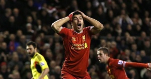 Liverpool's Luis Suarez reacts during their English Premier League soccer match against Sunderland at Anfield in Liverpool, northern England March 26, 2014. REUTERS/Phil Noble/Files