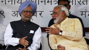 Prime Minister Manmohan Singh (L) speaks with Gujarat's chief minister and Hindu nationalist Narendra Modi, the prime ministerial candidate for India's main opposition Bharatiya Janata Party (BJP) during the inauguration ceremony of Sardar Vallabhbhai Patel national museum in Ahmedabad October 29, 2013. REUTERS/Amit Dave/Files