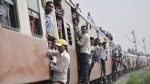 Passengers travel on an overcrowded train at Loni town in the northern Indian state of Uttar Pradesh July 8, 2014. REUTERS/Anindito Mukherjee