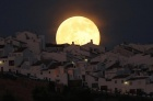 The Supermoon rises over houses in Olvera, in the southern Spanish province of Cadiz, July 12, 2014. REUTERS/Jon Nazca
