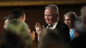 Actor Jon Voight applauds, as his daughter, actress Angelina Jolie, is announced recipient of the Jean Hersholt Humanitarian Award at the 5th Annual Academy of Motion Picture Arts and Sciences Governors Awards at The Ray Dolby Ballroom in Hollywood, California November 16, 2013.  REUTERS/Mario Anzuoni/Files