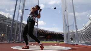 India's Chandrodaya Narayan Singh competes in the qualification round for the Men's Hammer Throw at the 2014 Commonwealth Games in Glasgow, Scotland, July 28, 2014.  REUTERS/Suzanne Plunkett