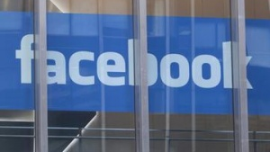 The Facebook logo is displayed in a window at the offices of J.P. Morgan in New York City, New York, May 4, 2012.  REUTERS/Lee Celano/Files