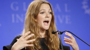 Actress Drew Barrymore speaks at a news conference supporting the efforts of the World Food Programme during the Clinton Global Initiative in New York, September 25, 2008. REUTERS/Chip East/Files