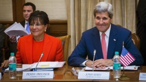 U.S. Secretary of State John Kerry (R) sits with Secretary of Commerce Penny Pritzker before a meeting with Indian Finance and Defense Minister Arun Jaitley (not pictured) in New Delhi July 31, 2014.  REUTERS/Lucas Jackson