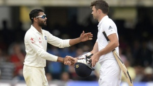 India's Ravindra Jadeja (L) shakes hands with England's James Anderson after India won the second cricket test match at Lord's cricket ground in London  July 21, 2014.  REUTERS/Philip Brown